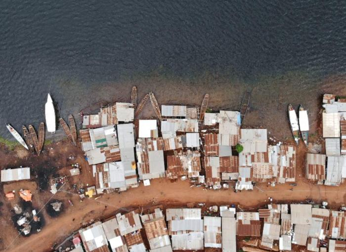 Aerial view of waterfront village in Uganda